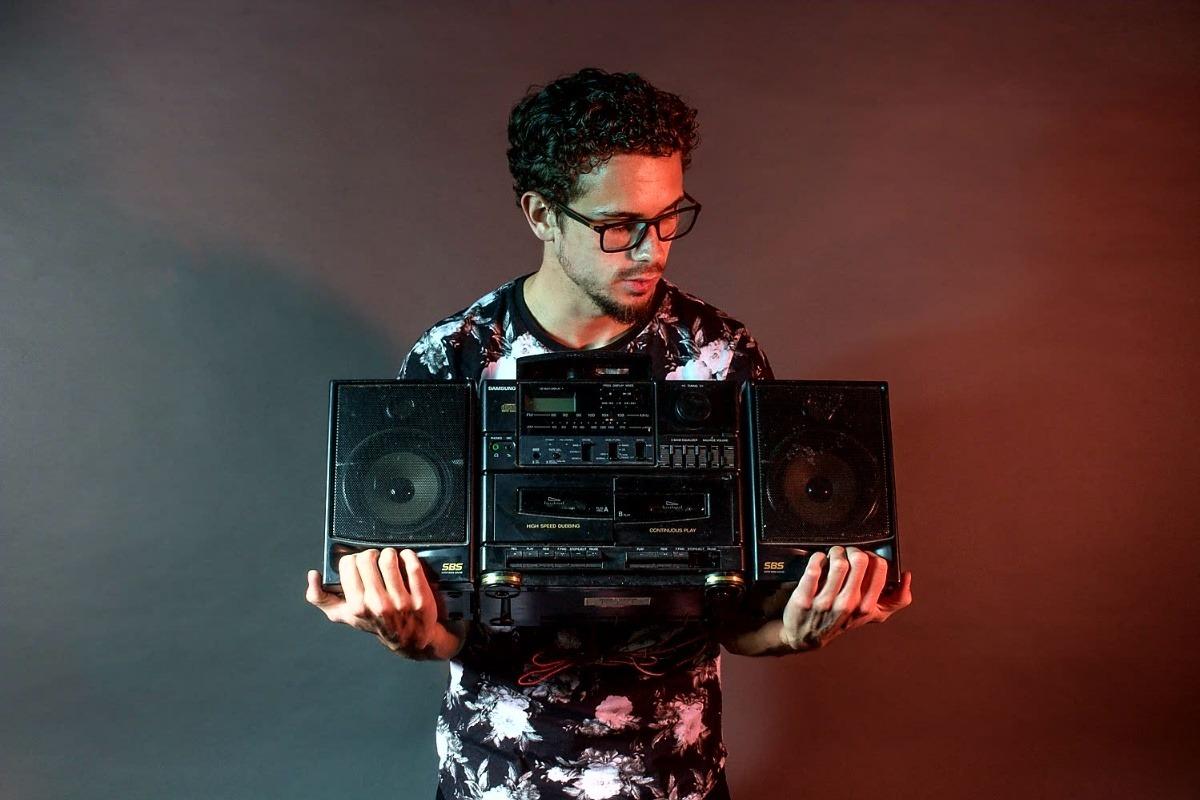 Man holding boombox