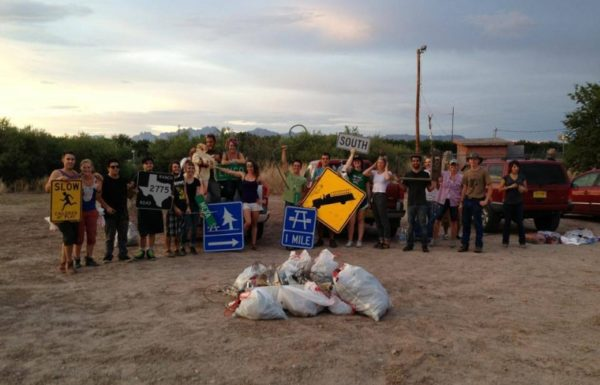 group of people doing a community trash pick up