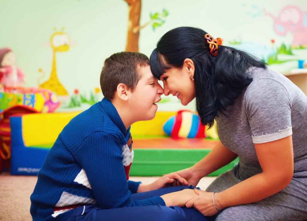 soulful moment, portrait of mother and her beloved son with disability in rehabilitation center
