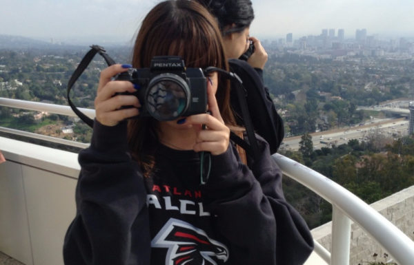 Woman taking photo on top of a viewpoint in the city