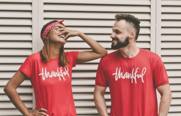 two people with shirts that say thankful