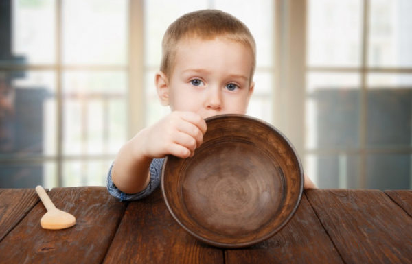 young boy with empty bowl
