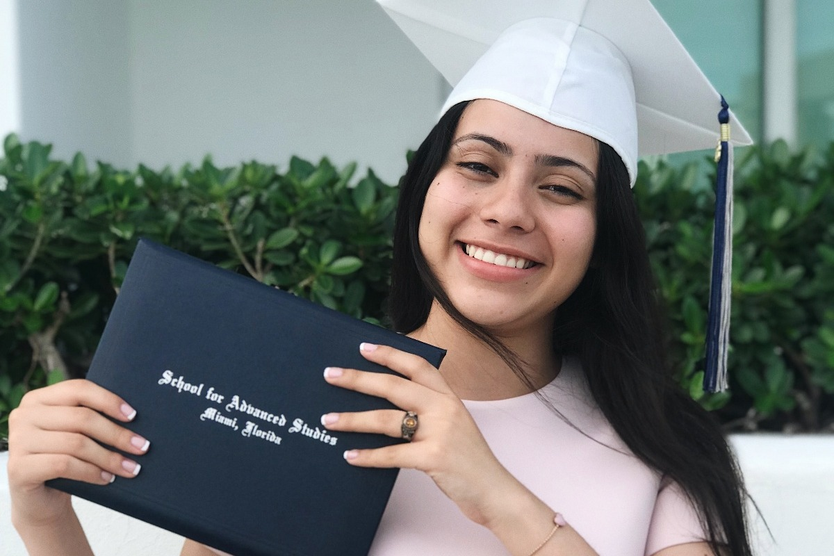 young woman graduating from college