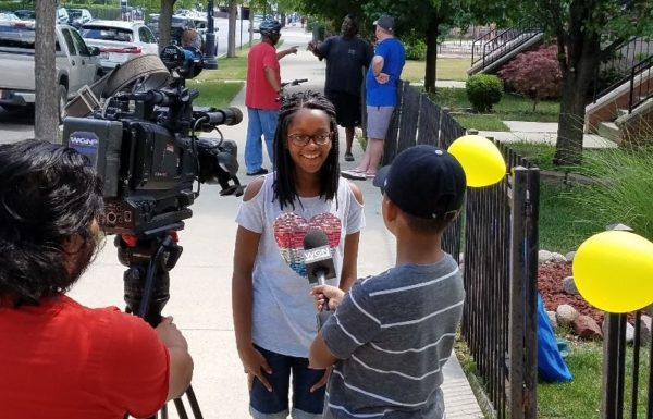 young girl being interviewed for lemonade stand