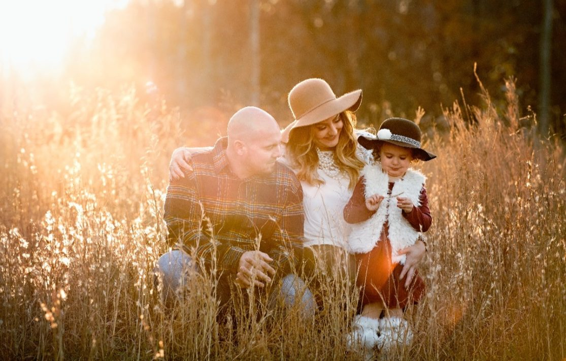 wife and husband with daughter