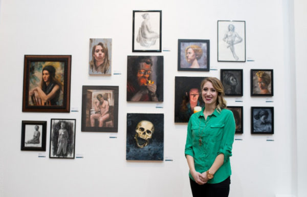 woman with art exhibit