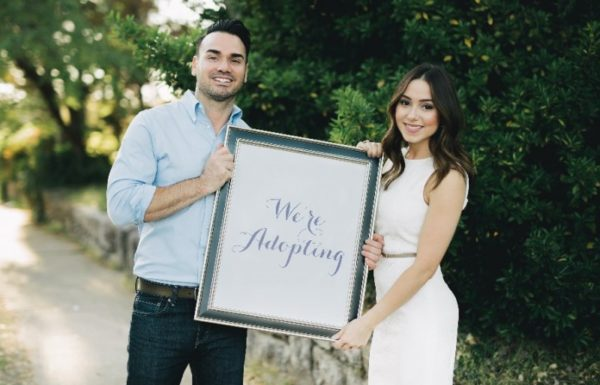 couple with adoption sign
