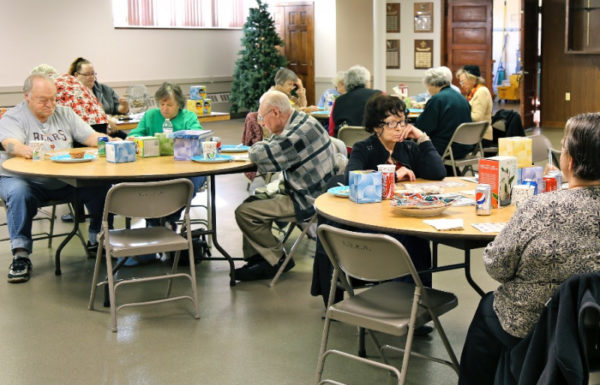 elderly people playing bingo