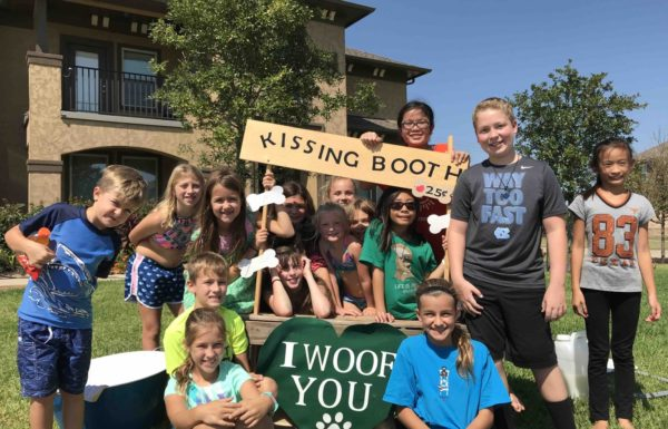 dog kissing booth fundraising event