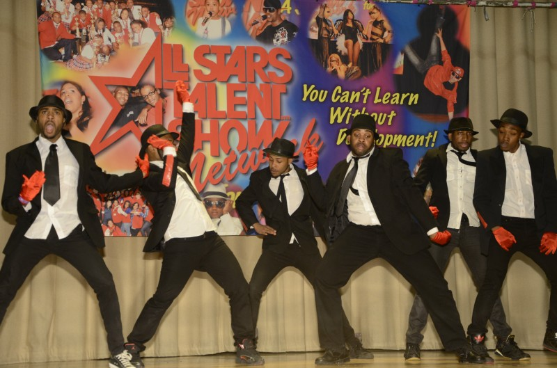 young men performing in talent show