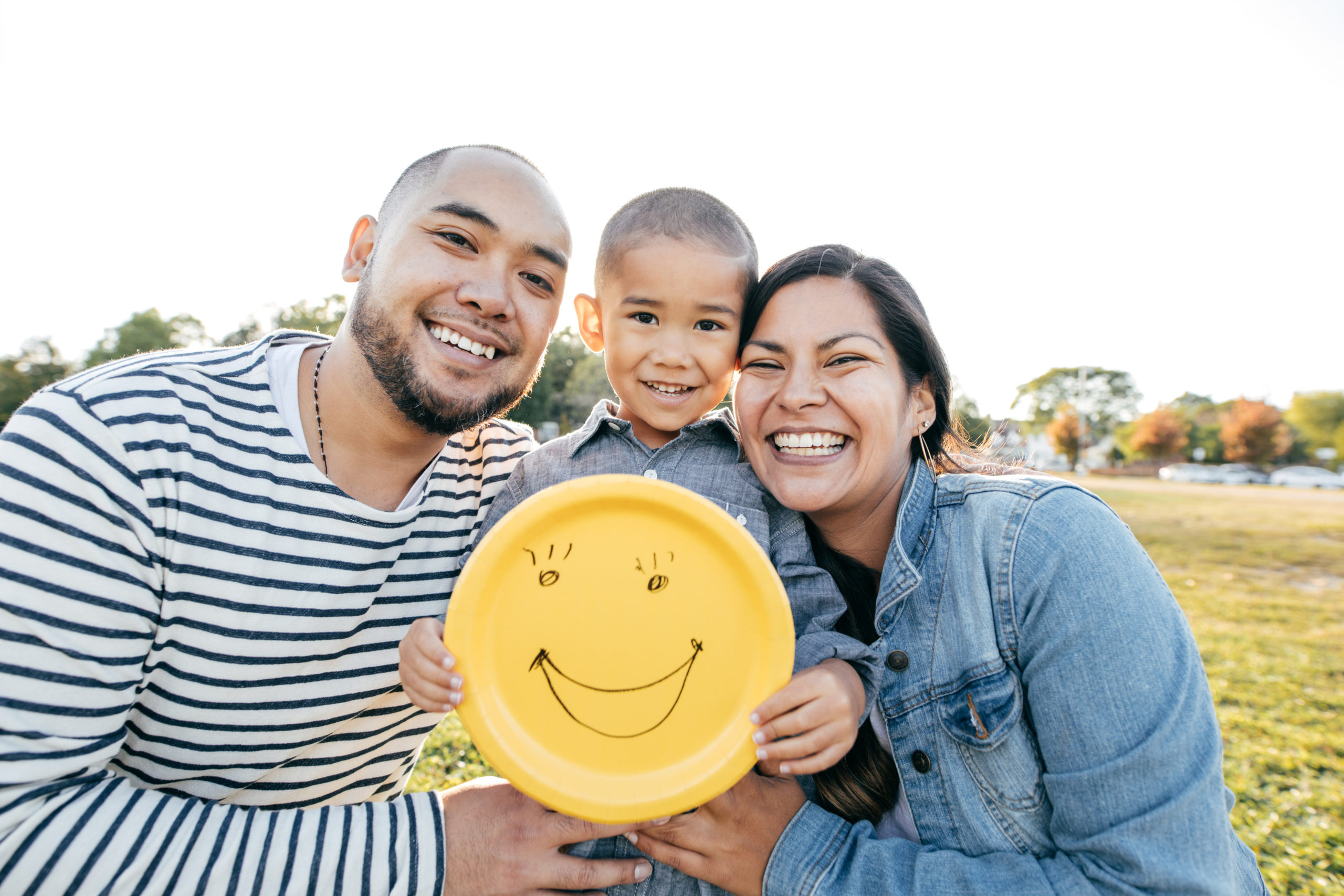 young family with kid smiling