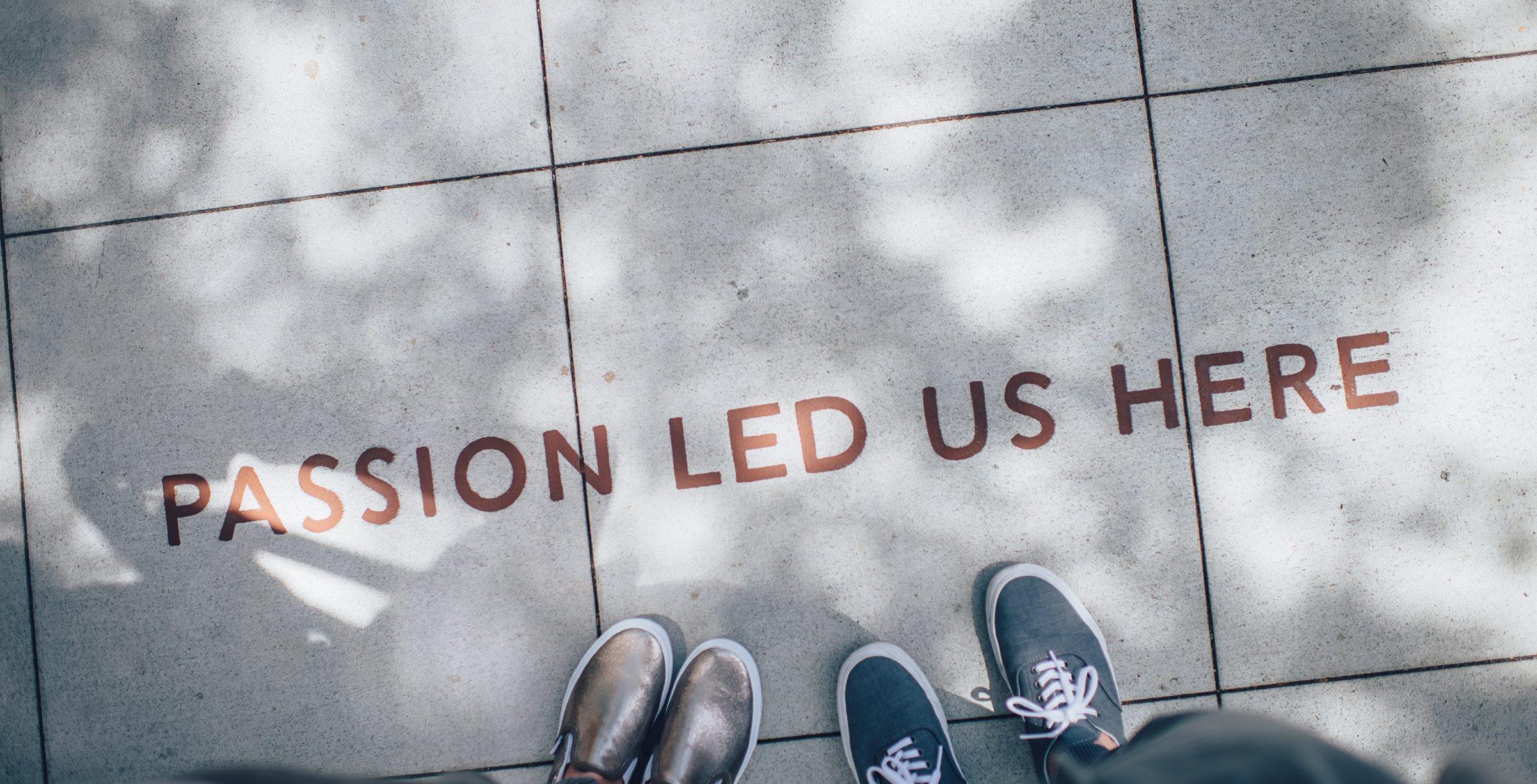 passion led us here written on sidewalk