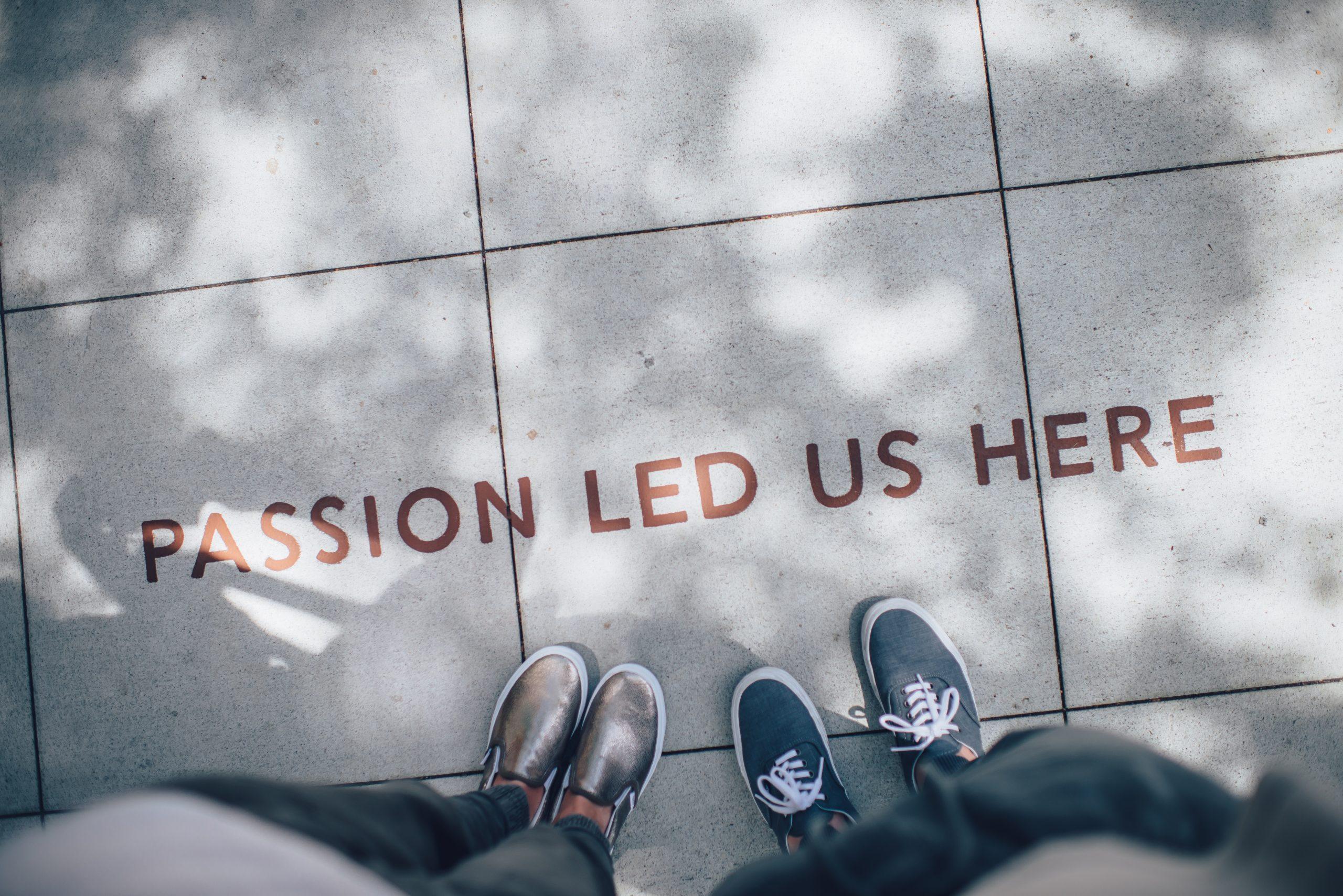 'Passion led us here' written on sidewalk