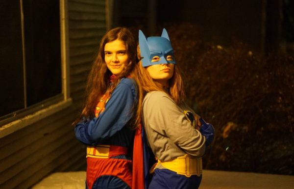 two young girls dressed as batman and superman