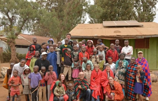 A group of children in Africa pose with missionaries.