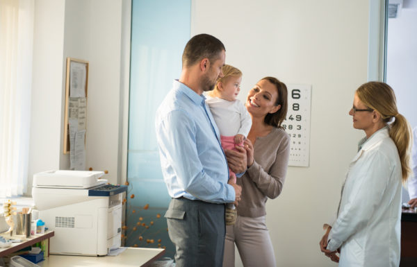 Pediatrician with baby and her Family.