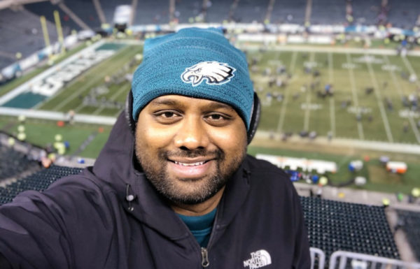 man with eagles hat