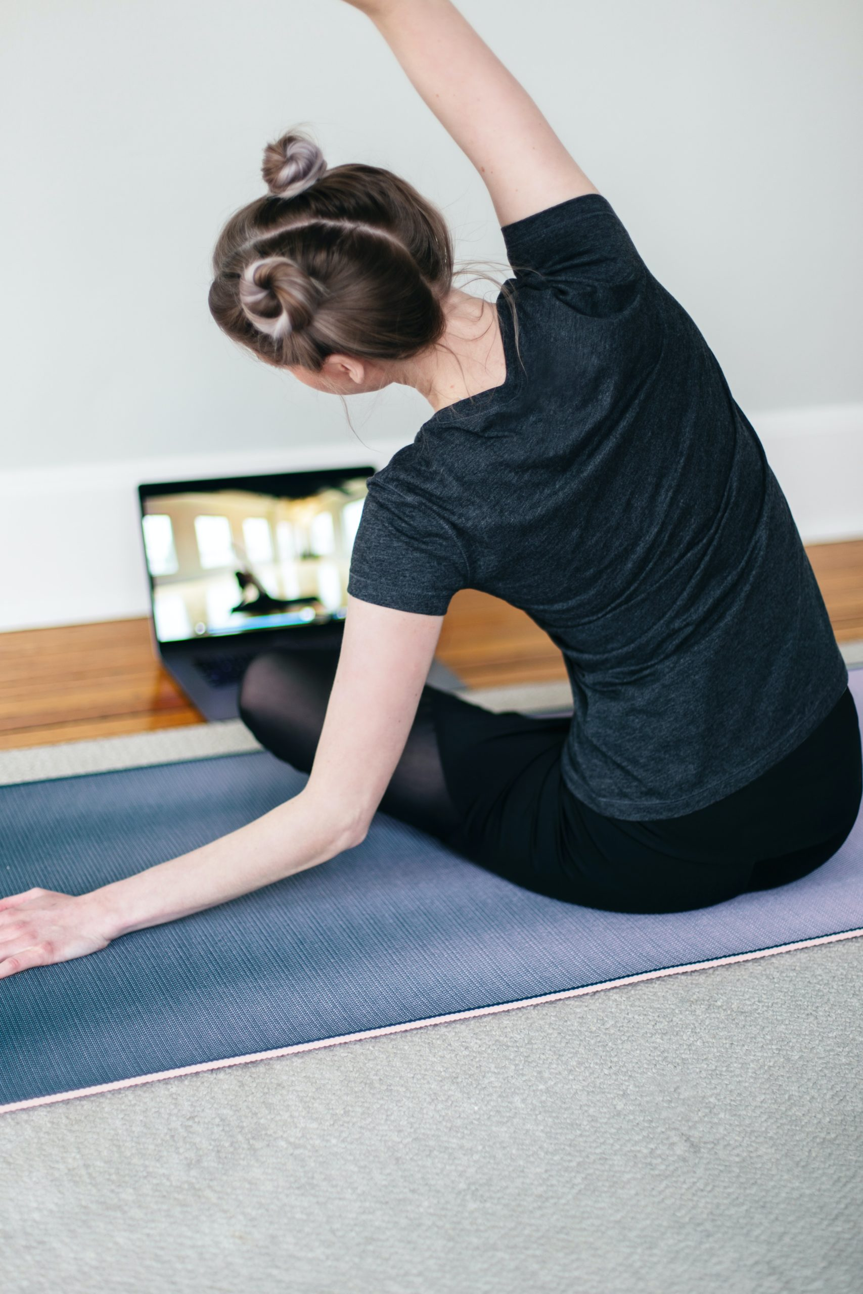 A teenage girl doing online yoga