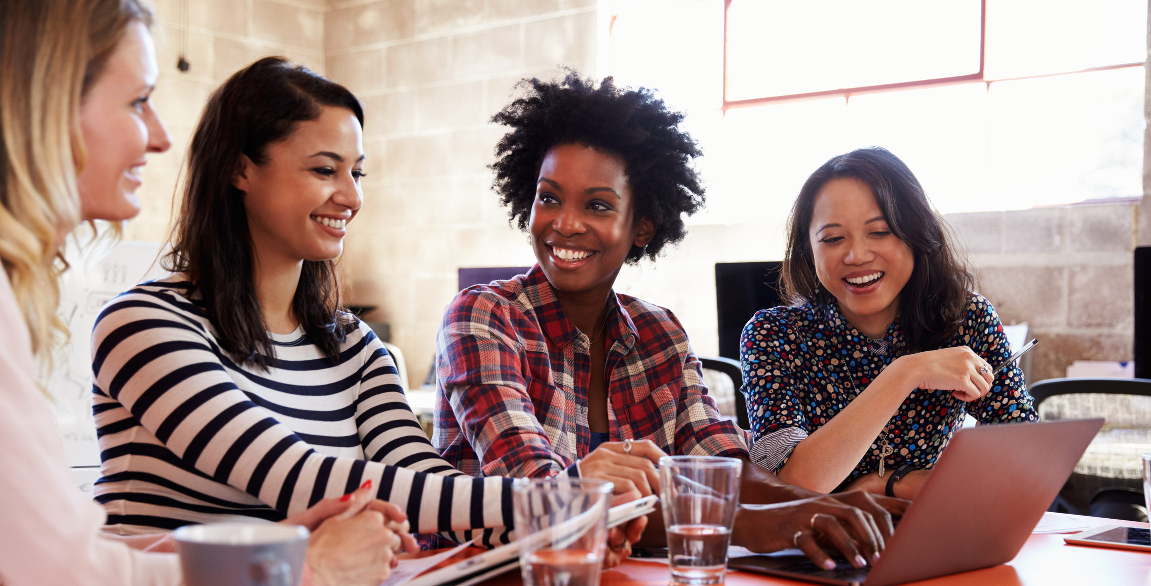 four woman working together