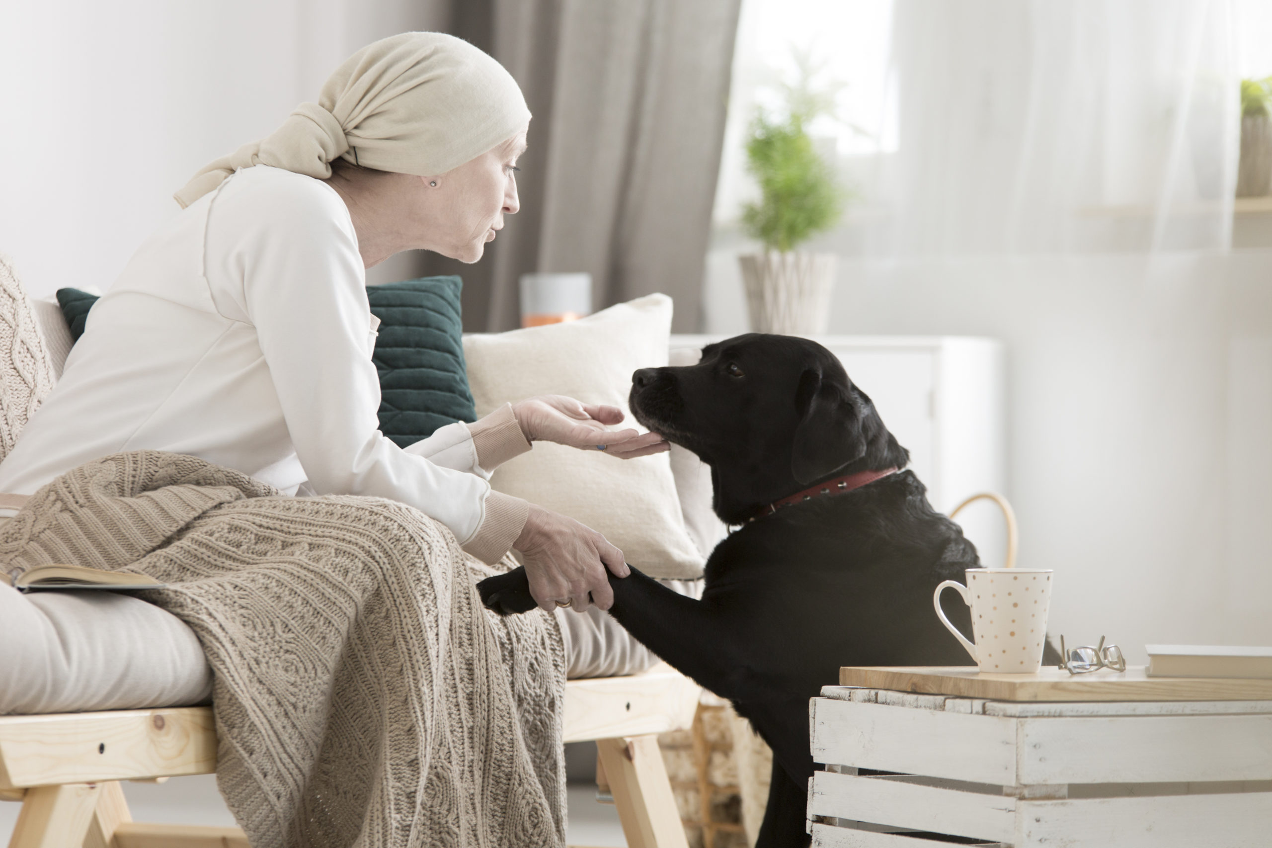 woman with cancer with her dog