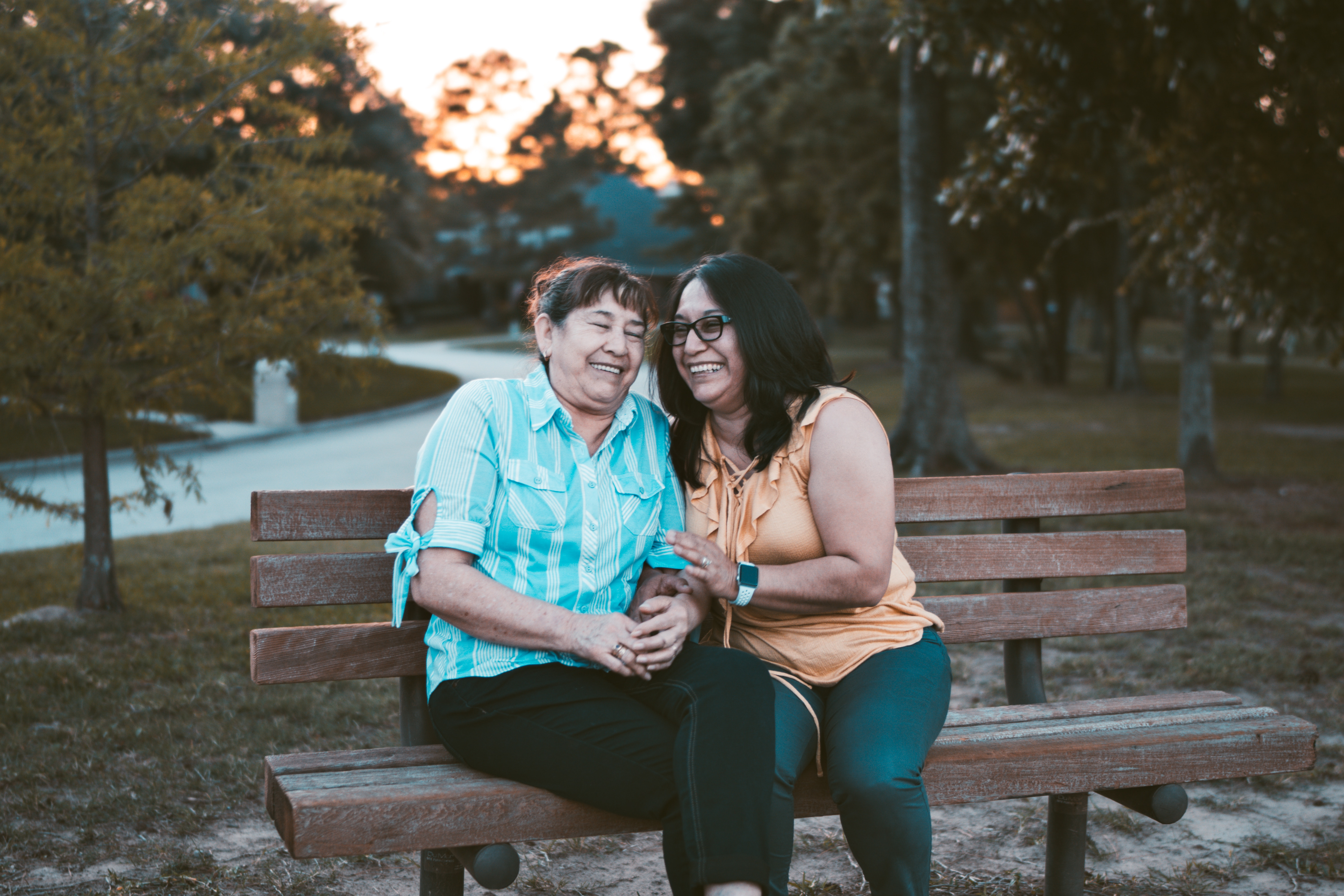 mom and daughter sitting on bench