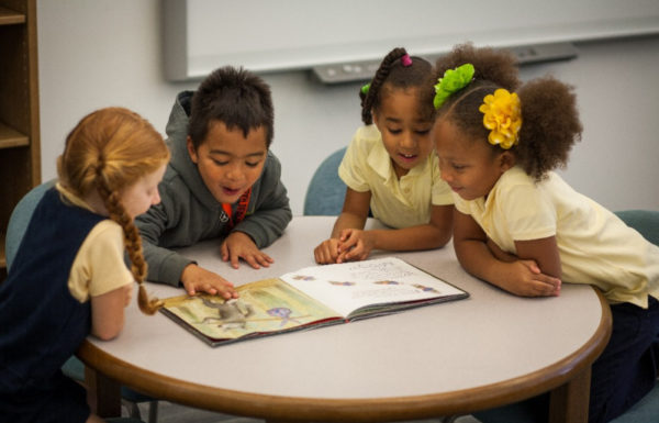 kids in a classroom reading