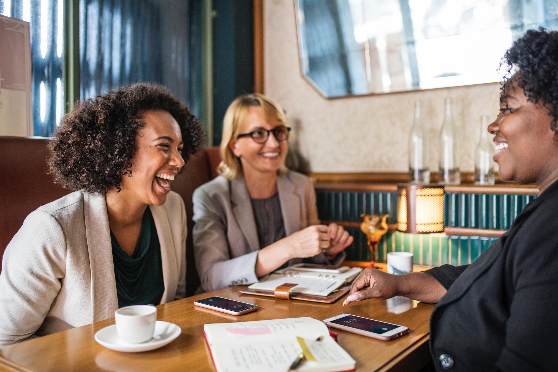 three women having a meeting