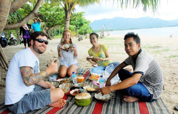 group eating on a beach
