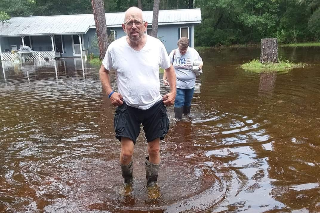 man in flood waters