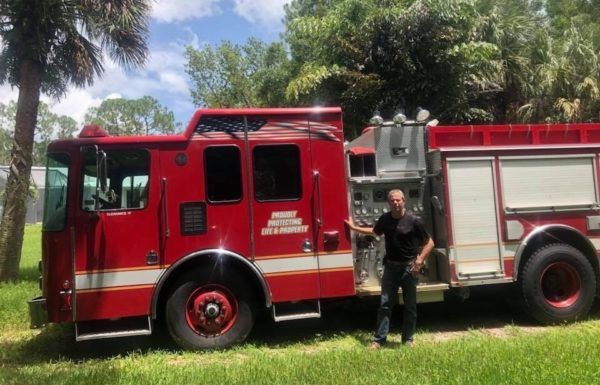 firefighter in front of fire truck