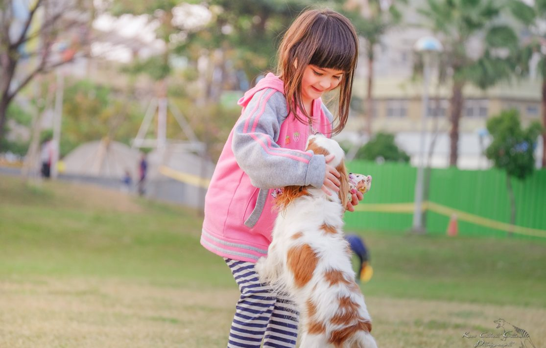 girl with pet dog