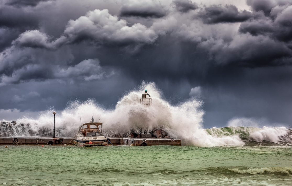 stormy ocean with boats