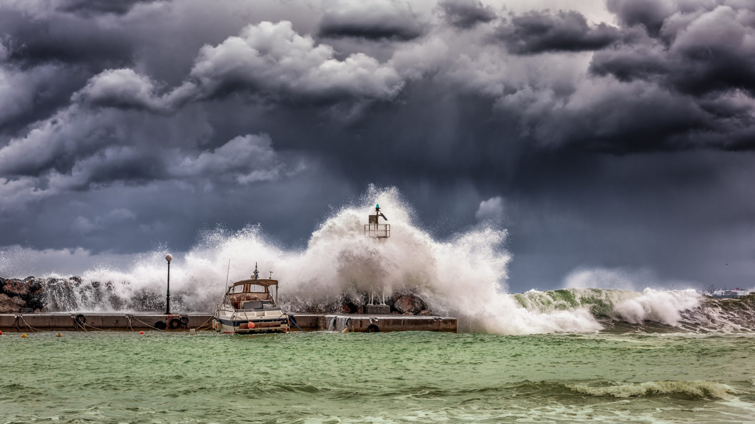 stormy ocean with boats and dark cloudy skies