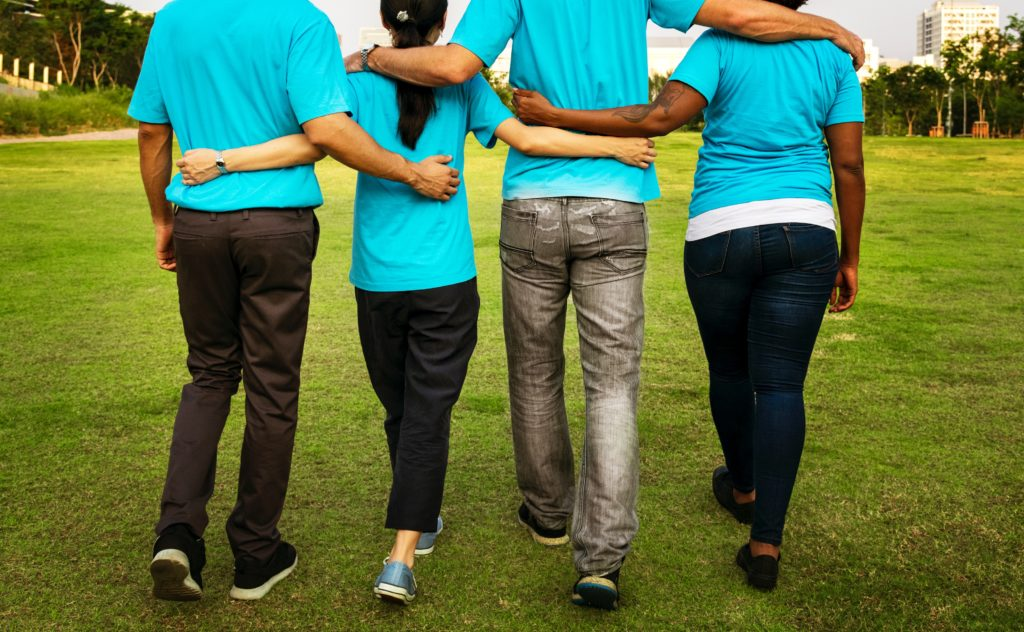 Four friends walking together