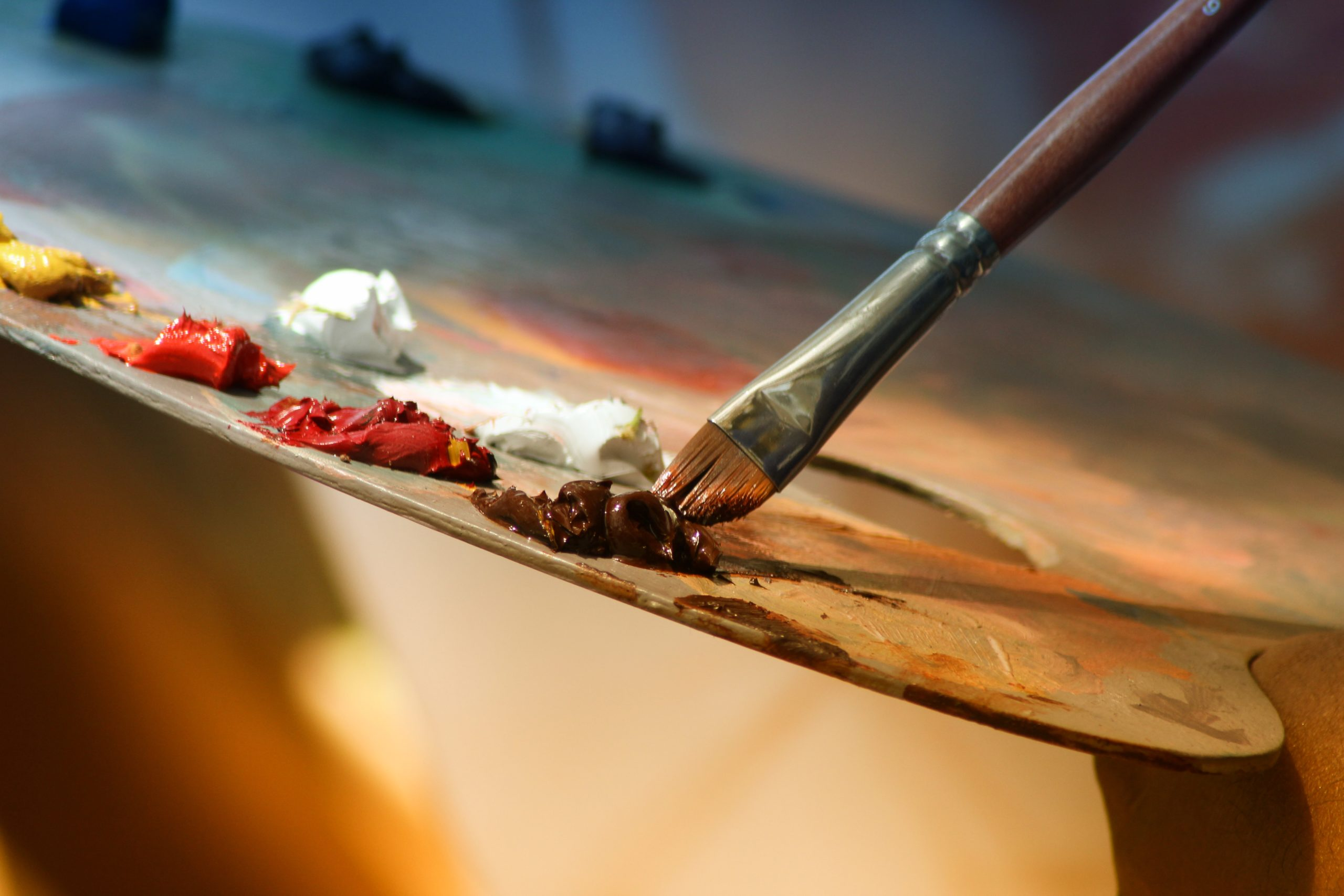 Paintbrush and paints on a palette