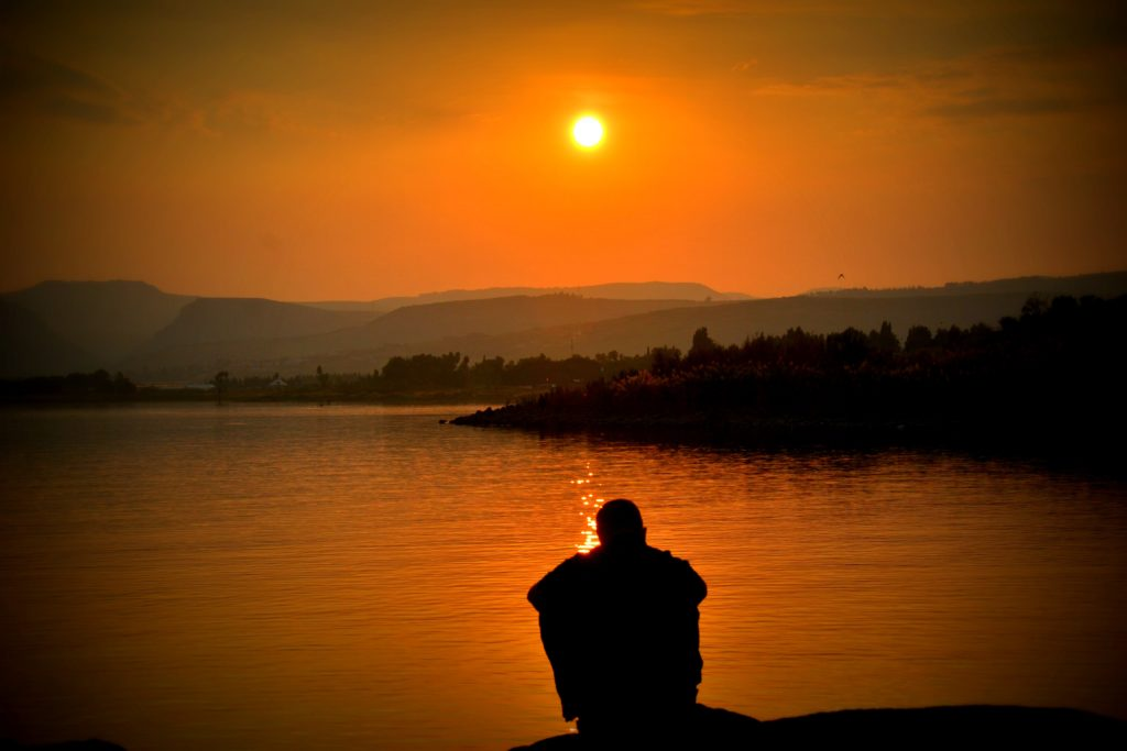 Man looking at a sunset