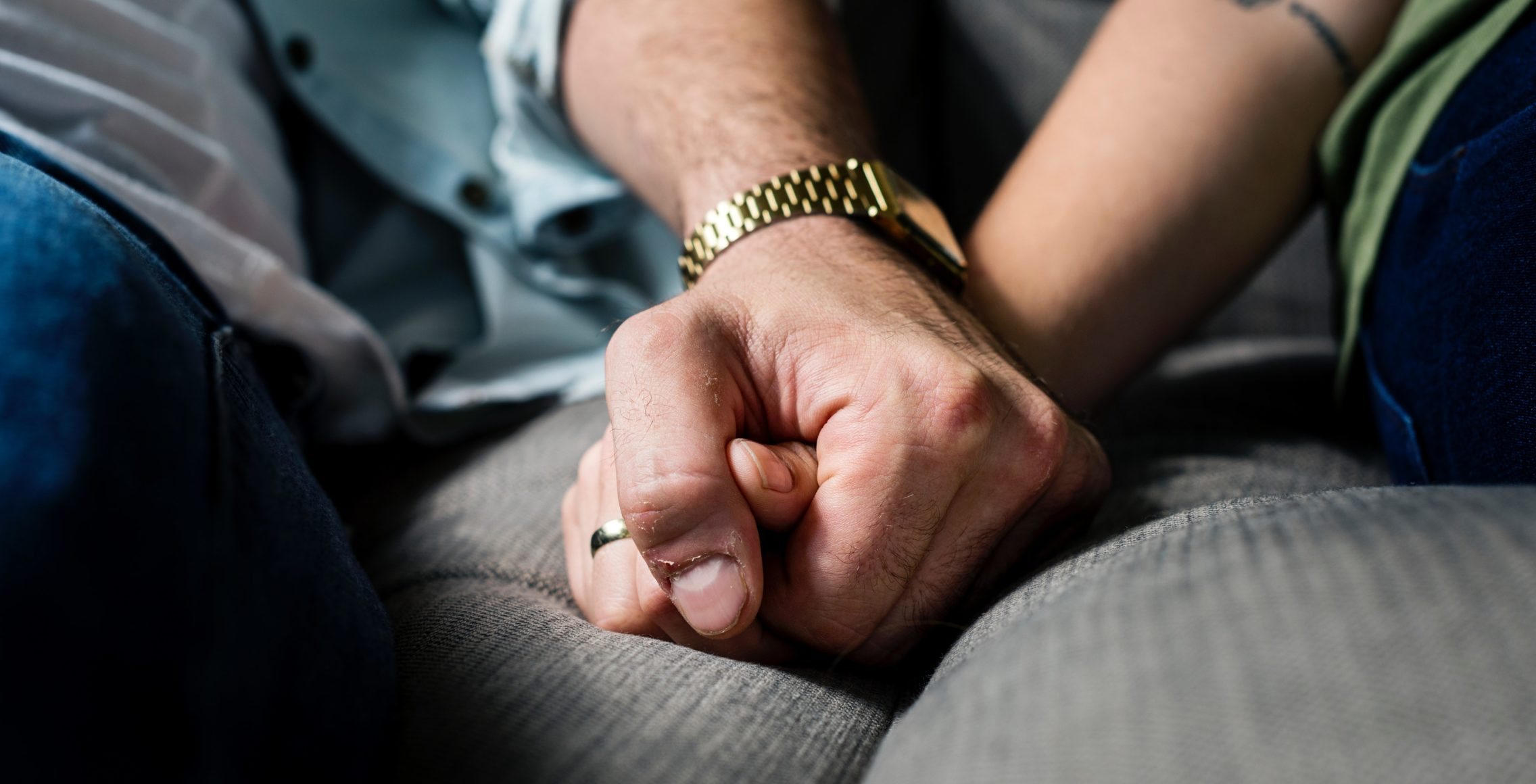 Two adults holding hands