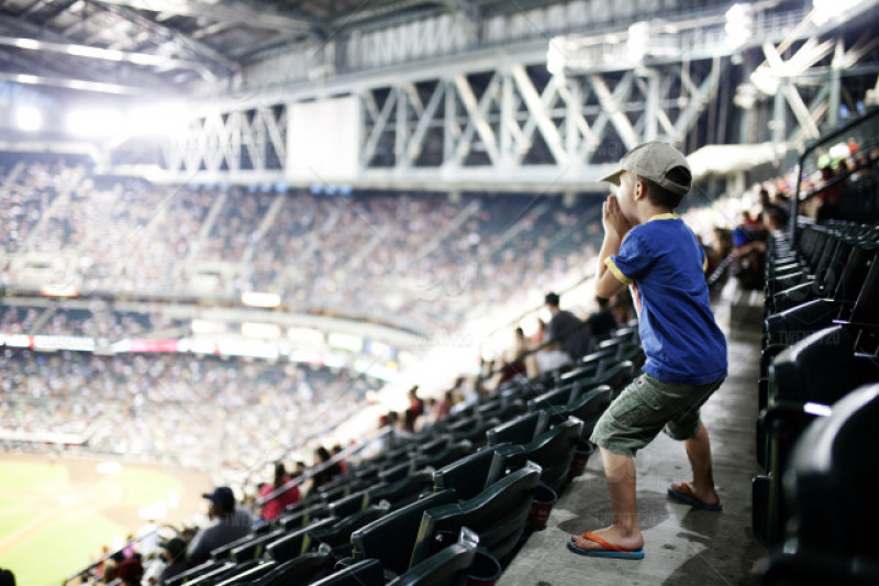 little boy yelling at ball park