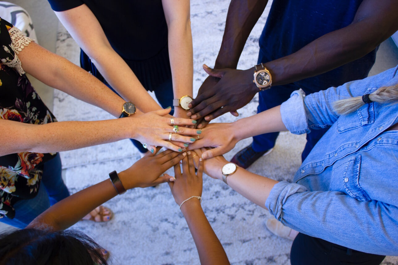 people with hands in a circle