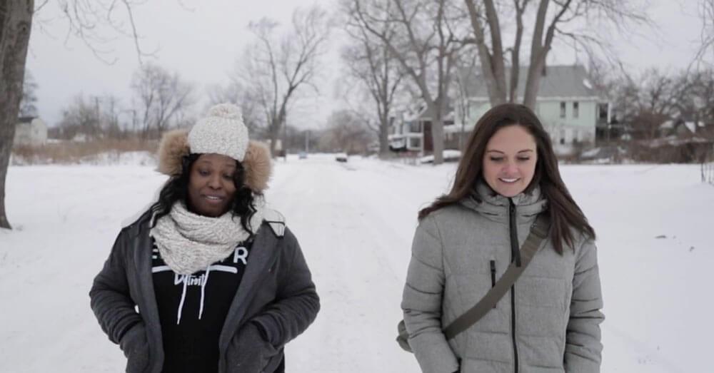 Two women walking in the snow
