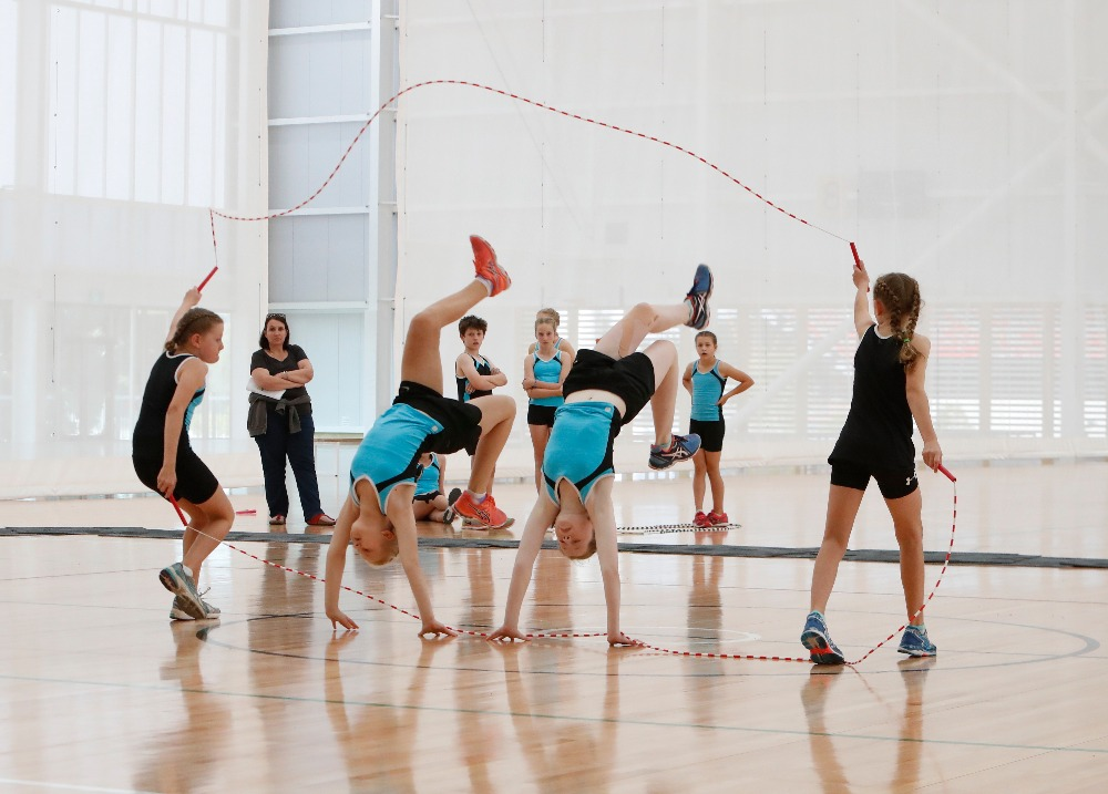 group of children jump roping