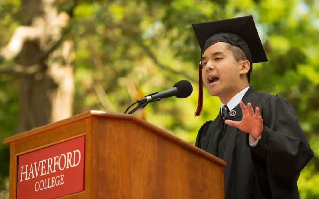 young graduate speaking into microphone at haverford college