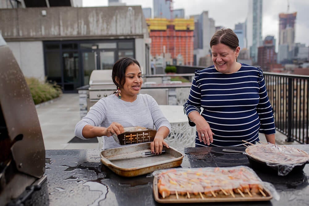 two women packaging food for the community