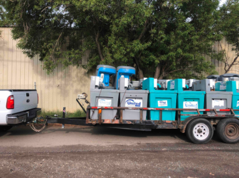 truck pulling portable sanitation stations on a trailer