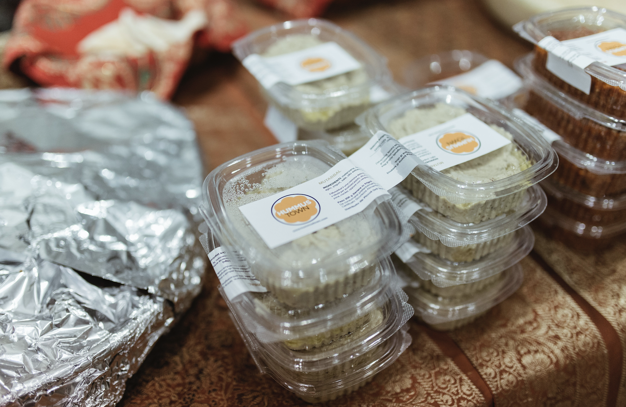 hummus packed in to-go containers on a table
