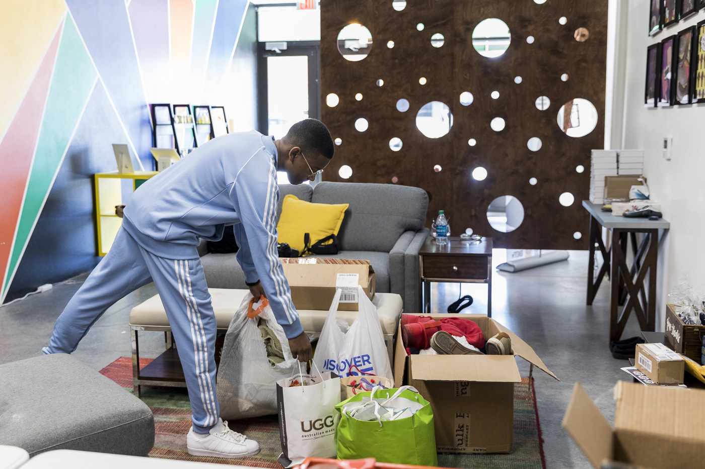 young man packs bags of donations to give to folks in need