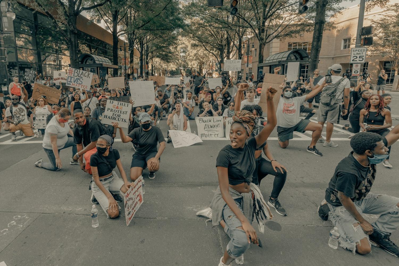 black lives matter protesters kneeling in the street