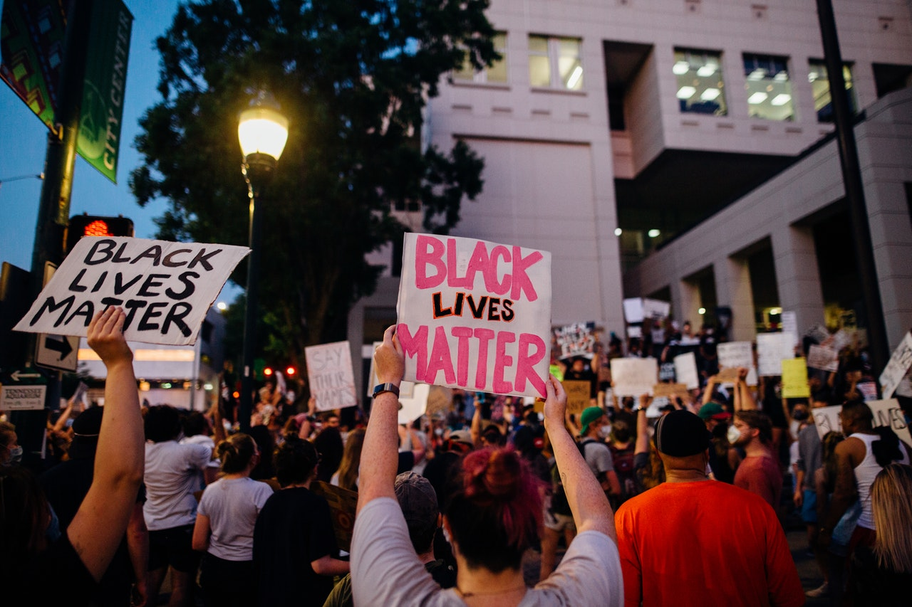 Protesters holding up Black Lives Matter signs