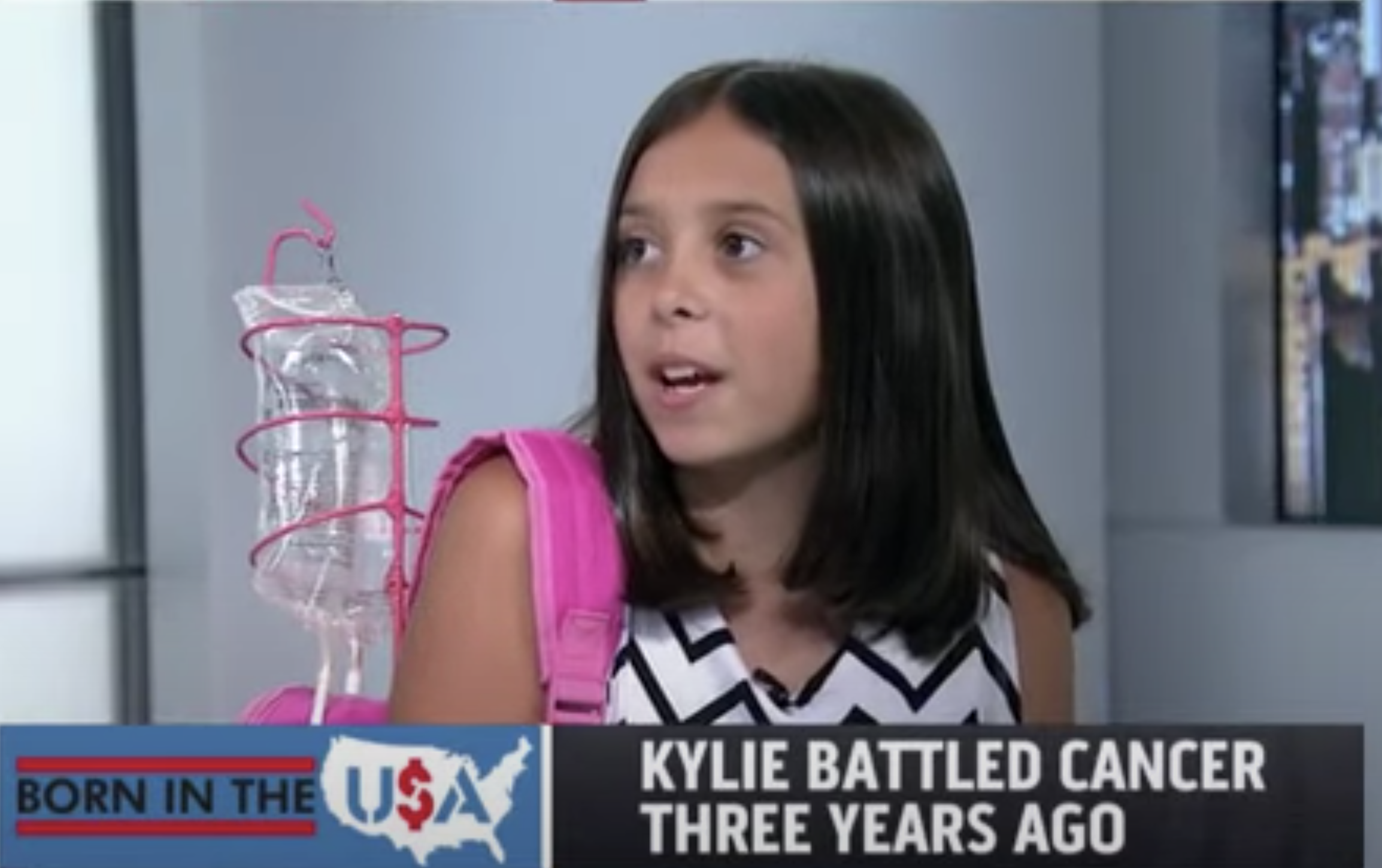 young cancer survivor talking on local news about her IV backpack prototype