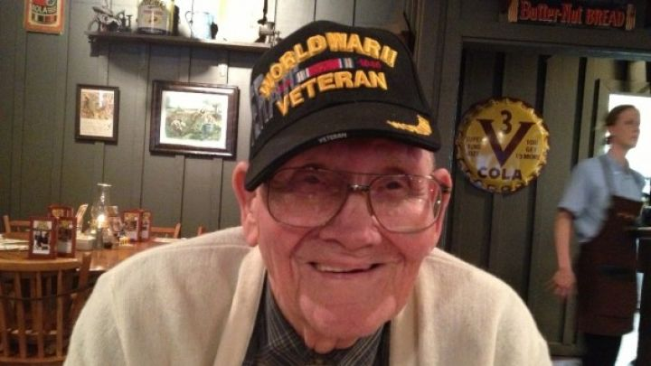 Veteran smiling for a photo at a restaurant